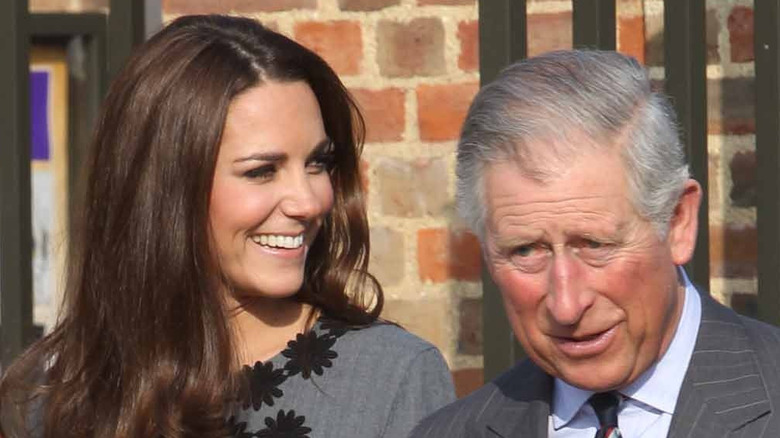 Prince Charles and Kate Middleton at an event.