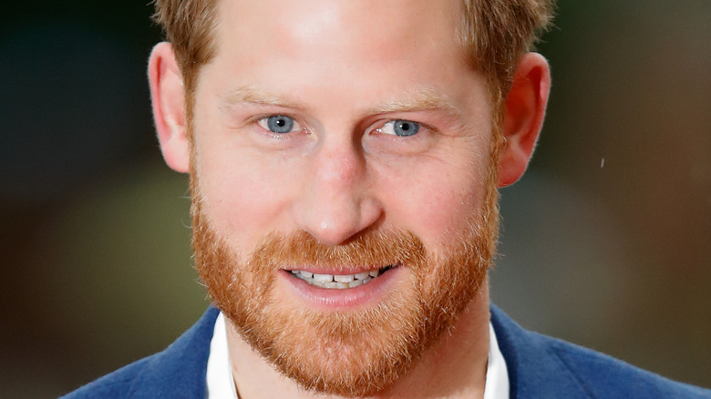 Prince Harry smiling with facial hair