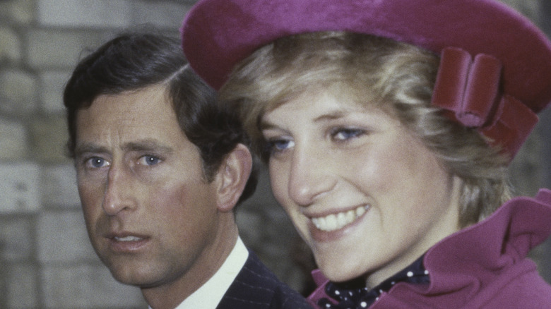 Princess Diana smiles next to Prince Charles