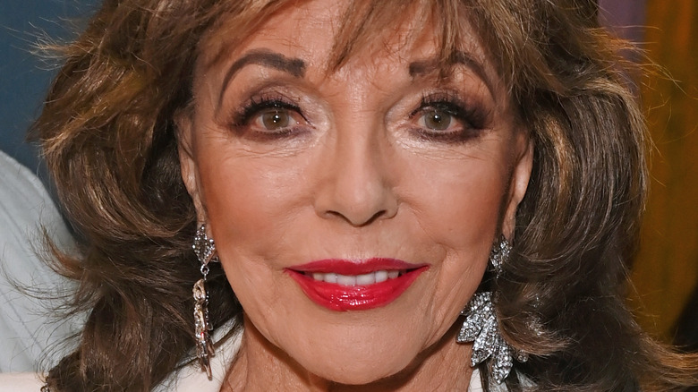 Joan Collins at an event.