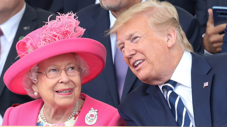 Queen Elizabeth smiling with Donald Trump