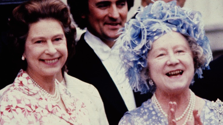 Queen Elizabethn is seen with her late mother in a fancy blue hat