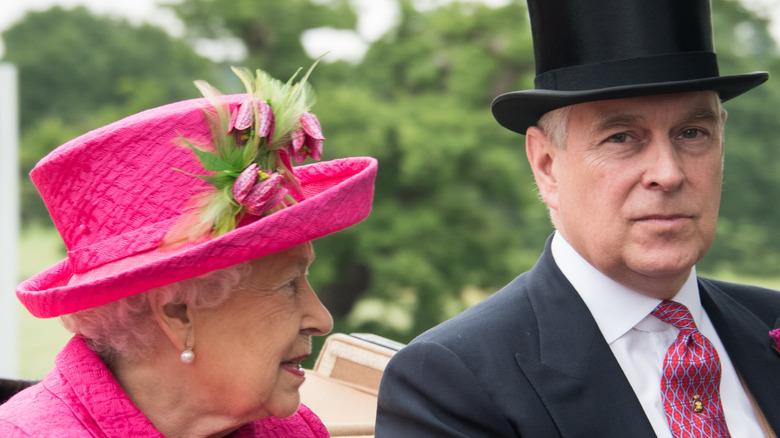 Queen Elizabeth in pink and Prince Andrew in top hat