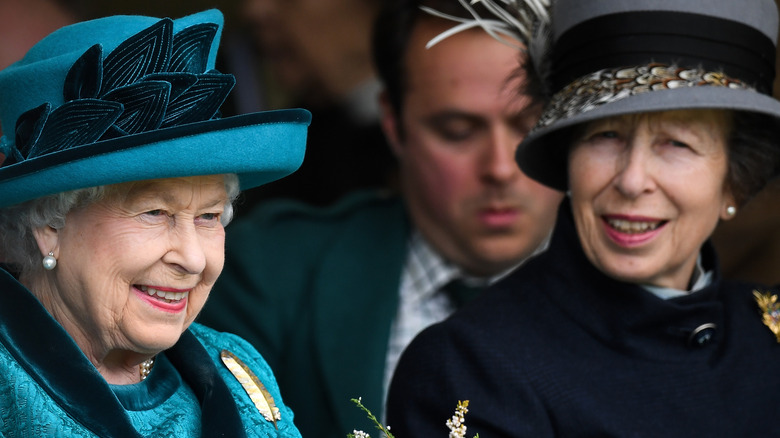Queen Elizabeth in blue and Princess Anne attend an event together
