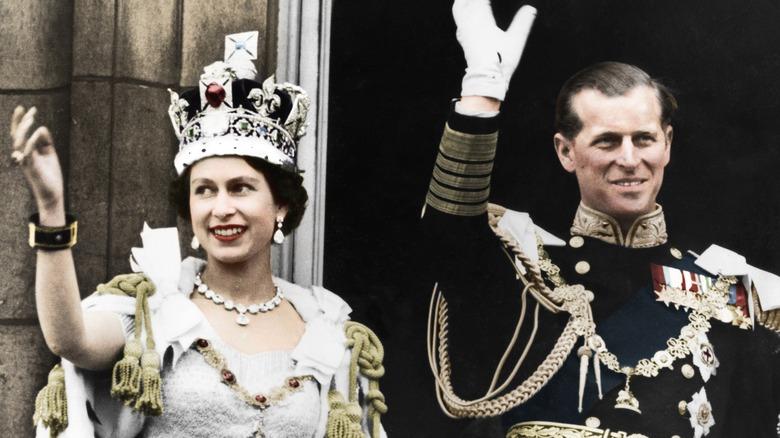Queen Elizabeth and Prince Philip waving