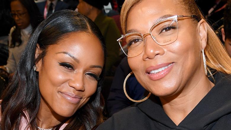 Queen Latifah and Eboni Nichols smile
