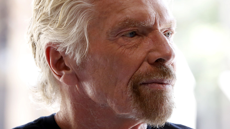 Richard Branson looking off to the side