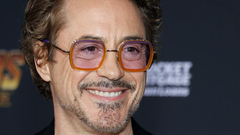 Robert Downey Jr. smiles at an event