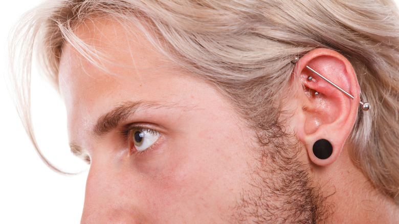 Man with rook piercing