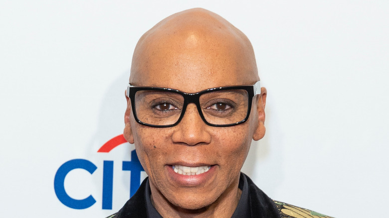 RuPaul poses on the red carpet