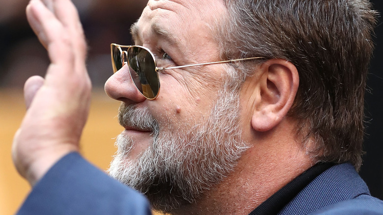 Russell Crowe smiles with beard
