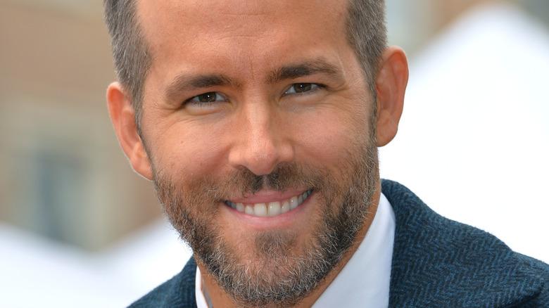 Bearded Ryan Reynolds smiling
