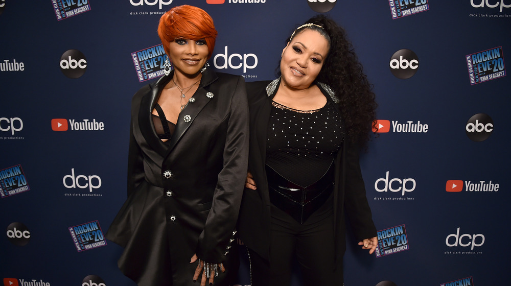 """Sandra """"Pepa"""" Denton and Cheryl """"Salt"""" James smiling on the red carpet for Dick Clark's New Year's Rockin' Eve with Ryan Seacrest in 2020"""