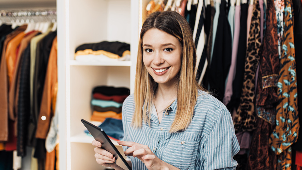 Woman on tablet in closet
