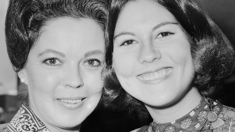 Shirley Temple and daughter smiling