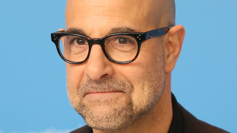 Stanley Tucci poses at a red carpet event