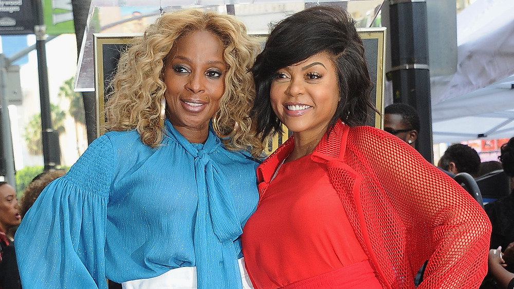 Mary J. Blige and Taraji P. Henson hugging on a red carpet