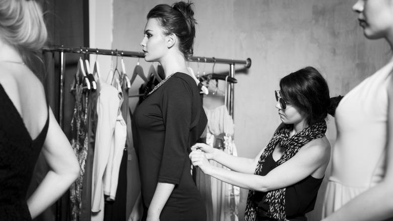 woman getting dress sized