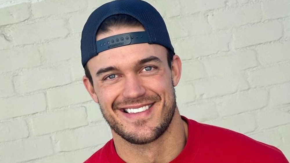 Ben Smith wearing a backwards baseball hat