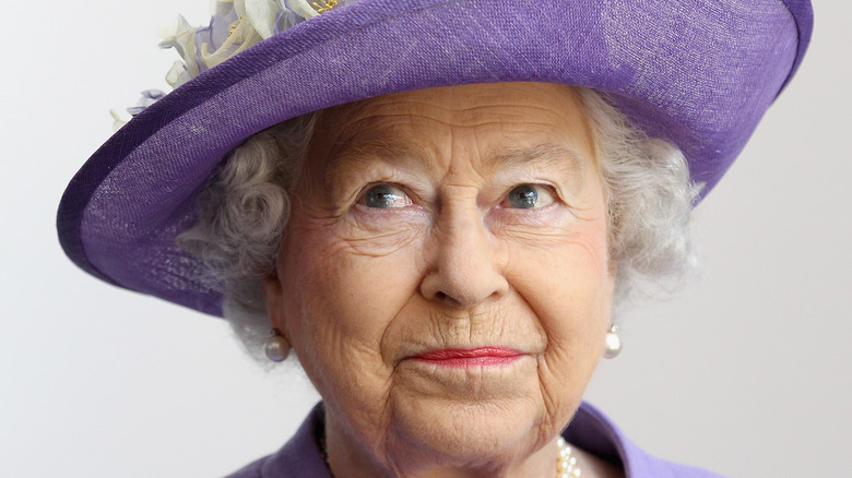 Queen Elizabeth wears purple hat