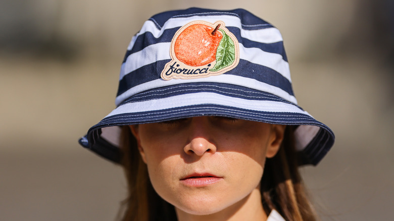 A striped bucket hat with a fruit on it