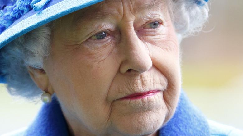 Queen Elizabeth II looking serious in blue