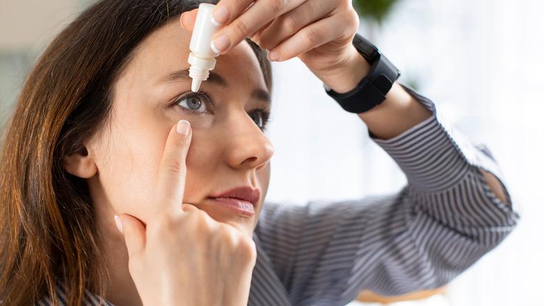 Woman using eye drops