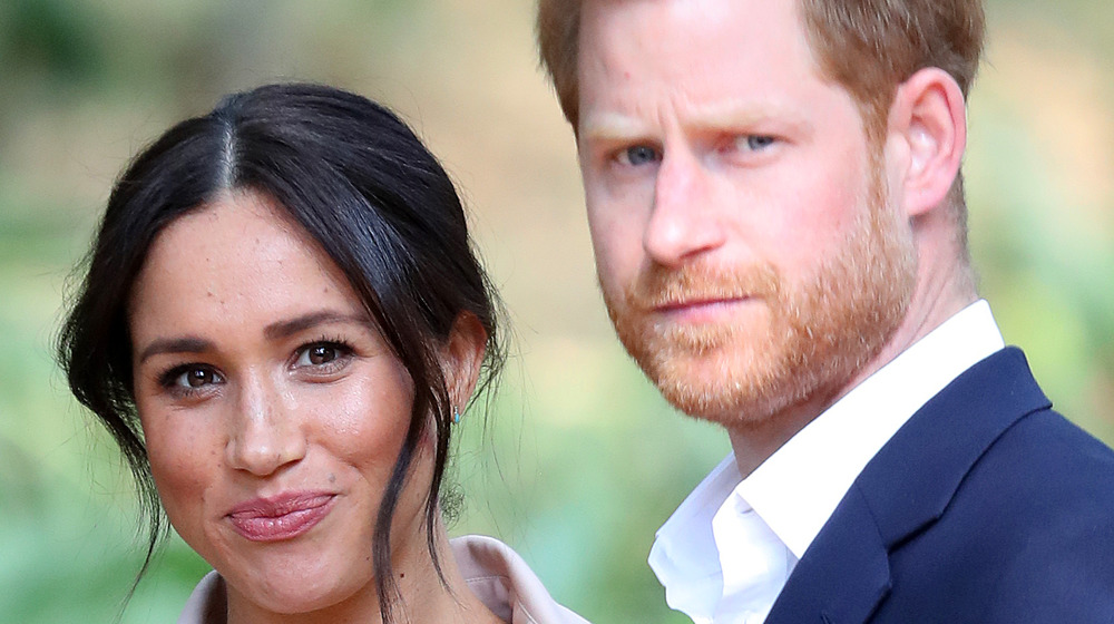 Meghan and Harry pose for an photo outdoors