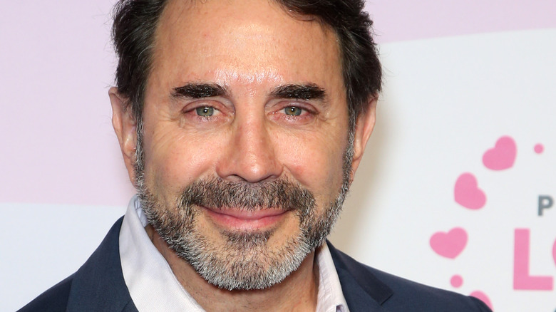 Dr. Paul Nassif smiles with facial hair