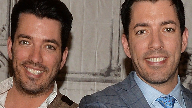 Property Brothers pose back-to-back