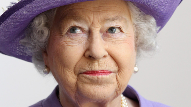 Queen Elizabeth wearing purple