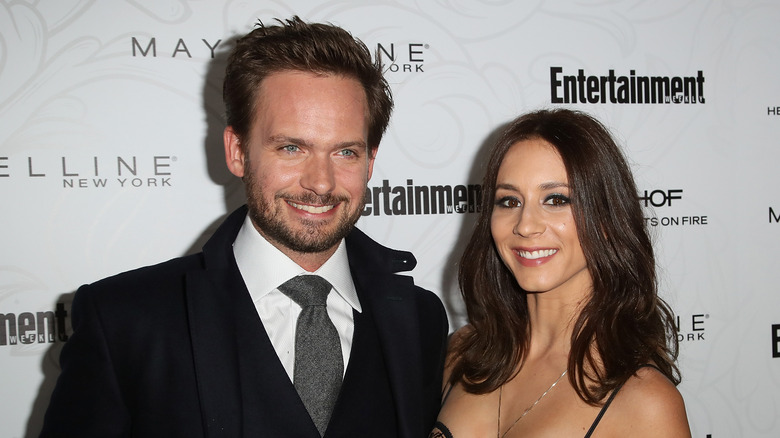 Patrick J. Adams and Troian Bellisario at a red carpet event