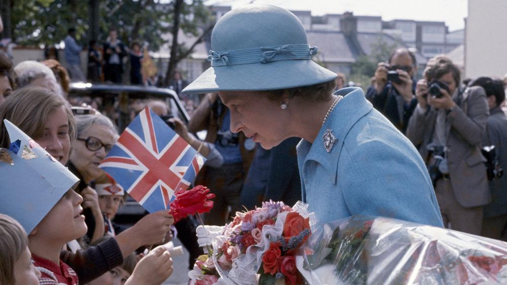 Queen Elizabeth II greeting fans