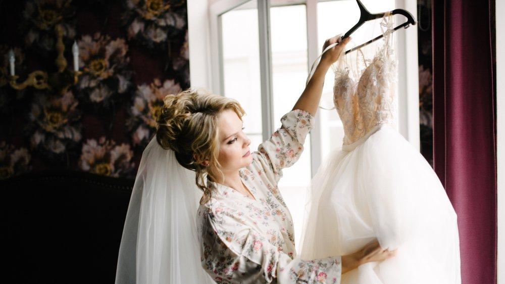 Bride examining wedding dress