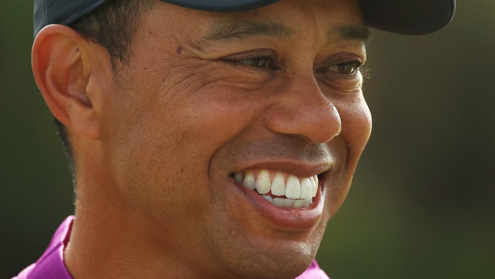 Tiger Woods smiling outside