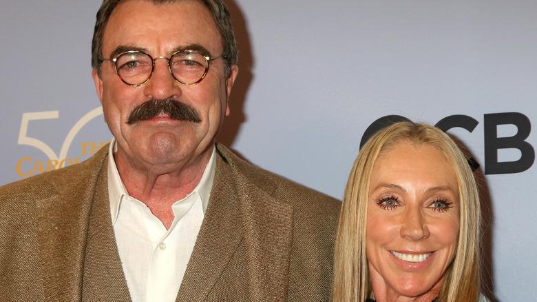 Tom Selleck and Jillie Mack attending an event