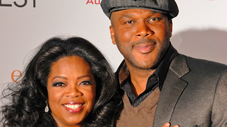 Tyler Perry and Oprah Winfrey pose together at an event