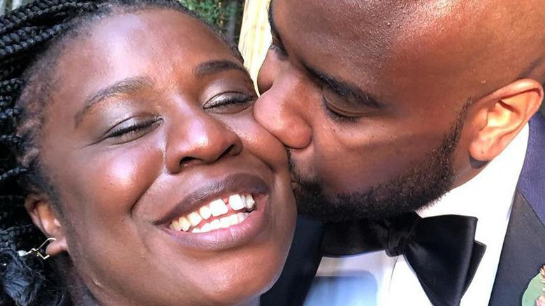 Robert Sweeting and actor Uzo Aduba kissing at their wedding