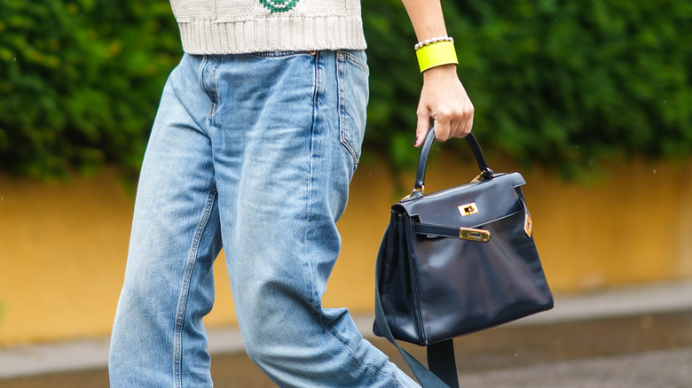 Mom jeans and purse