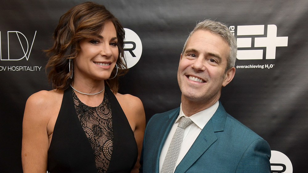 LuAnn de Lesseps and Andy Cohen pose on red carpet