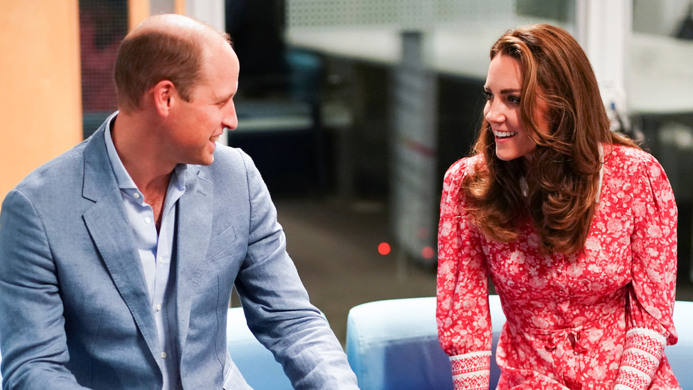 Prince William and Kate Middleton smiling at each other