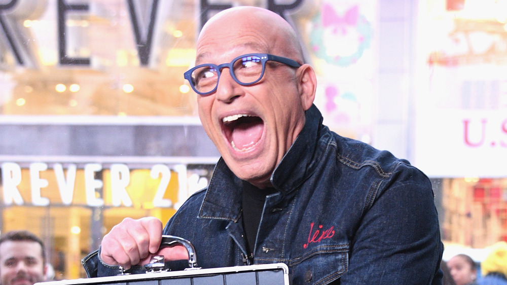 Howie Mandel smiles with case