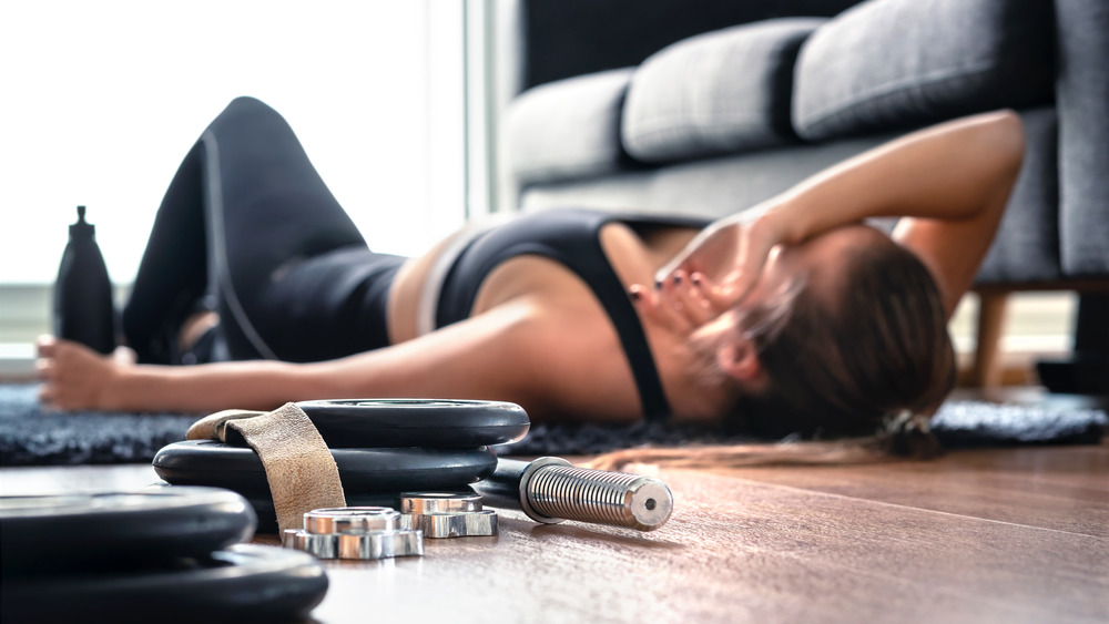 A tired woman working out on the floor
