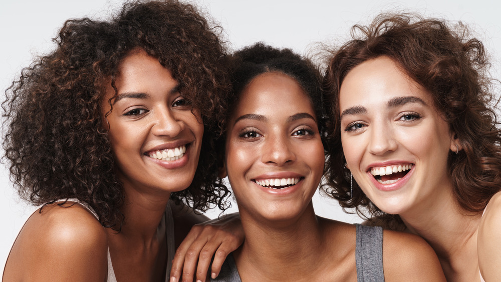 Three women with different complexions