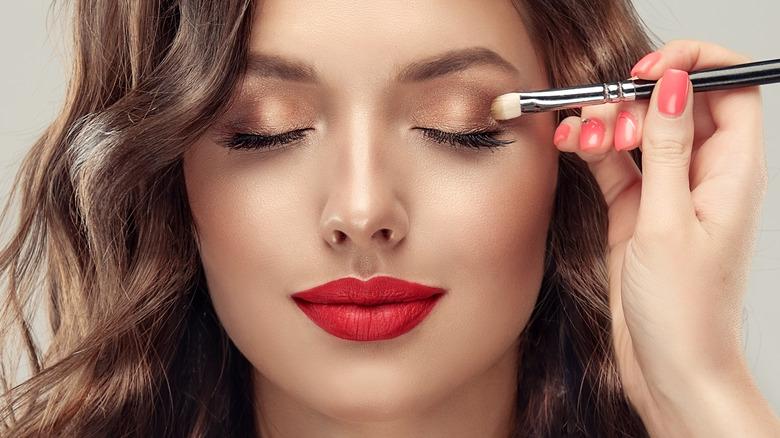 Applying eyeshadow and makeup