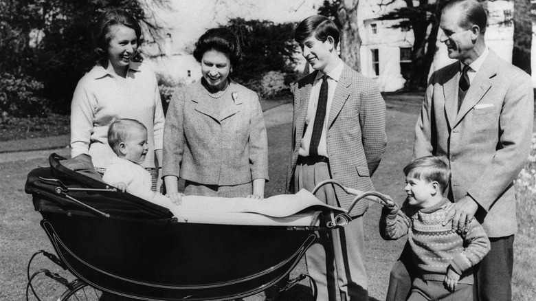 Queen Elizabeth and Prince Philip with their young kids
