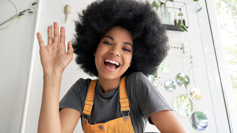 Girl with afro, waving