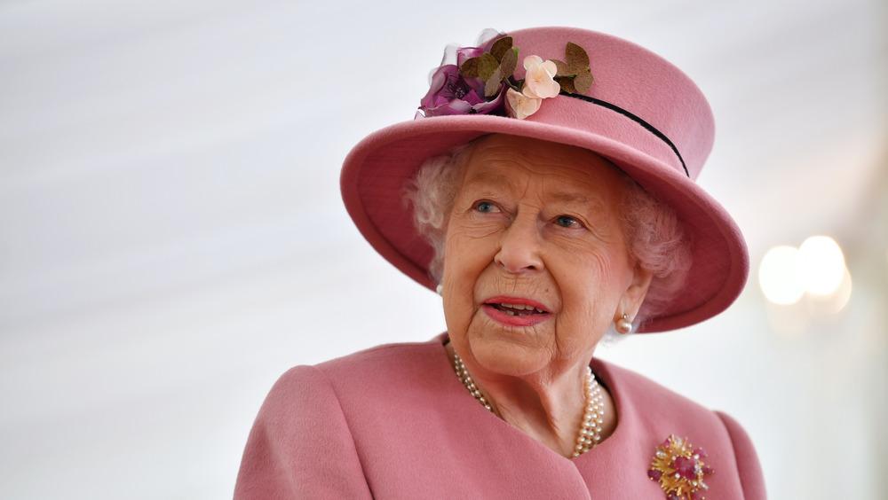 Queen Elizabeth II in pink hat and suit
