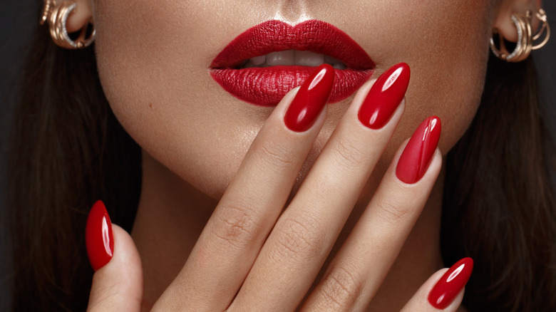 Red lips and red nails