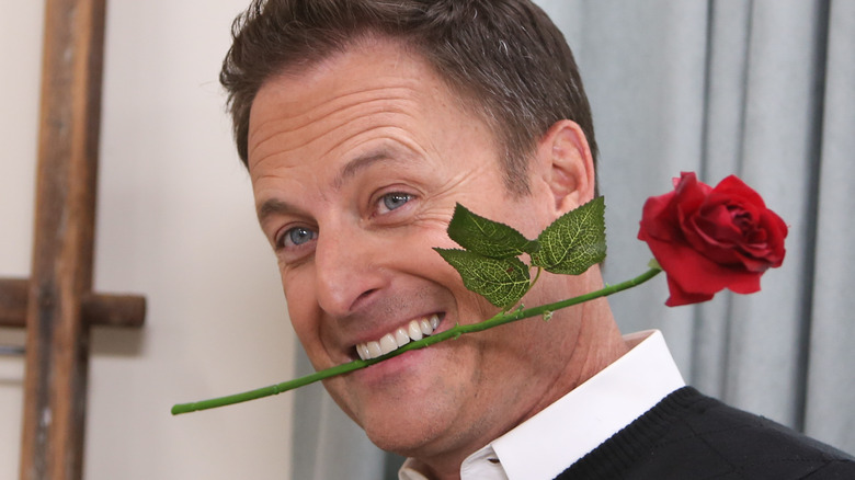 Chris Harrison with a rose